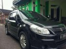 Suzuki SX4 Manual Tahun 2009 Type Cross Road Hitam